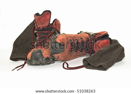 Dirty, used hiking boots and socks - stock photo