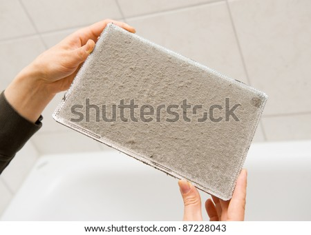 Dirty ventilation system filter - stock photo