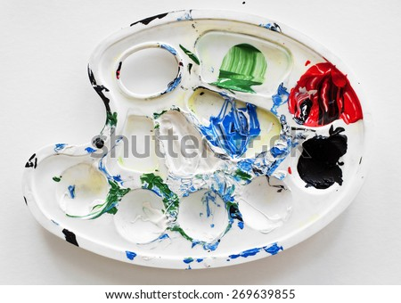 Dirty watercolor palette on white paper - stock photo