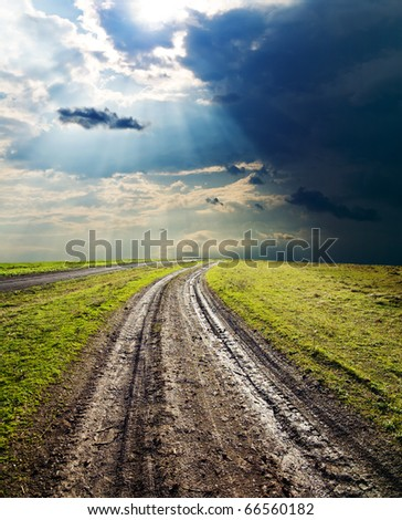 dirty way under dramatic sky - stock photo