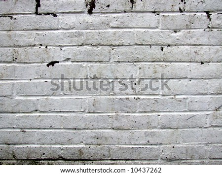 Dirty white brick wall - stock photo