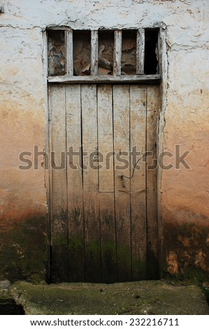 dirty white old wooden village door