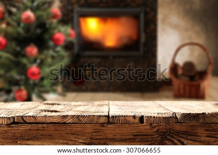 dirty wooden desk top place and fire in fireplace  - stock photo