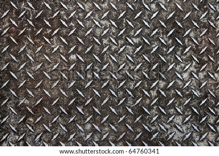 dirty worn old aluminum diamond plate non-skid surface background - stock photo