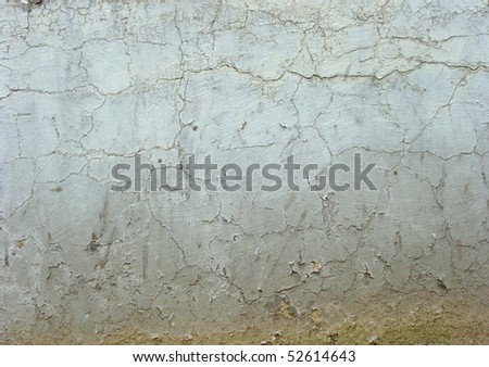 dirty worn white gray brown wall with cracks