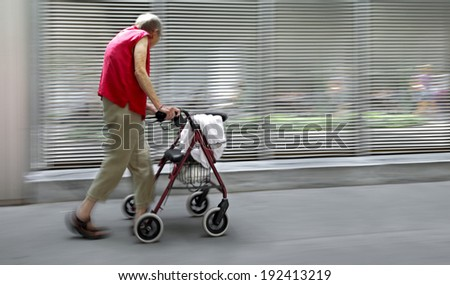 disabilities people on a city street  in a wheelchair, accompanied and modern style with a blurred background  - stock photo
