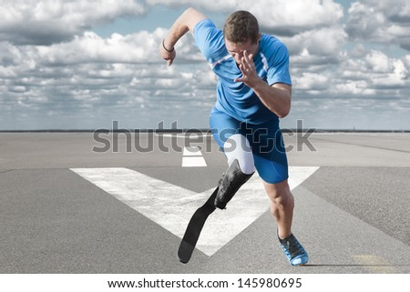 Disabled athlete with  explosive start on the runway - stock photo