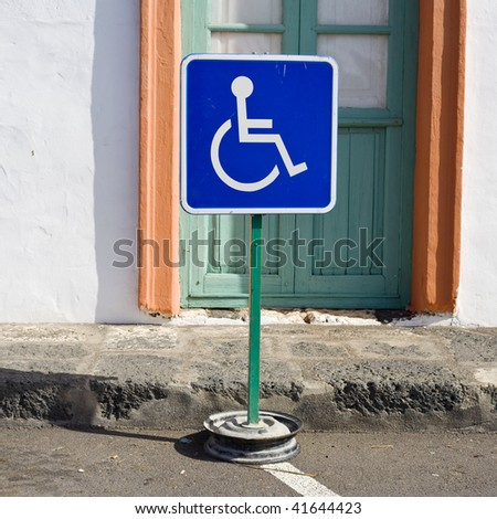 disabled blue sign on the street - stock photo