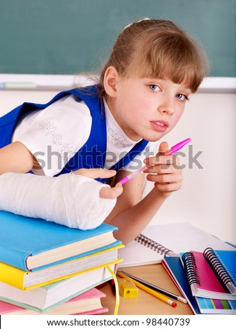 Disabled child with broken arm - stock photo