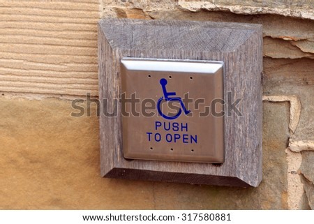 Disabled entry push button - stock photo