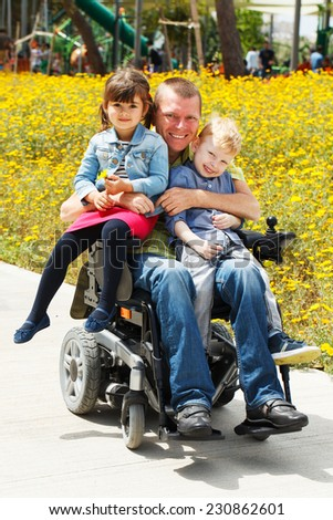 Disabled Father play with his little son and daughter
