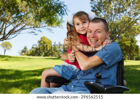 Disabled father with his little daughter. - stock photo