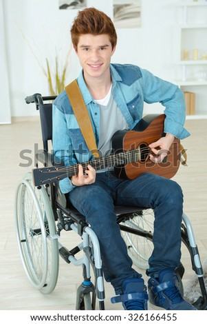 Disabled guitarist - stock photo