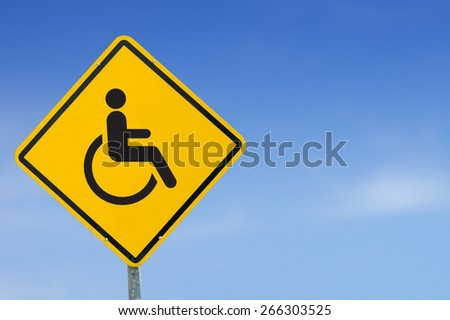 Disabled Handicap Icon yellow road sign on sky background - stock photo