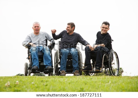 Disabled Happy friends having fun together outside. - stock photo