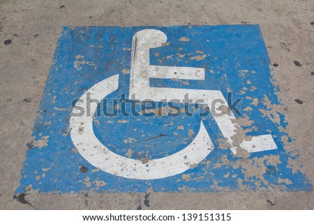 disabled icon on the street - stock photo