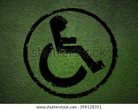 disabled icon sign, green old wall background. - stock photo