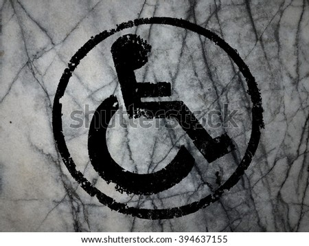 disabled icon sign, old wall background. - stock photo