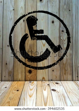 disabled icon sign, old wood wall background. - stock photo