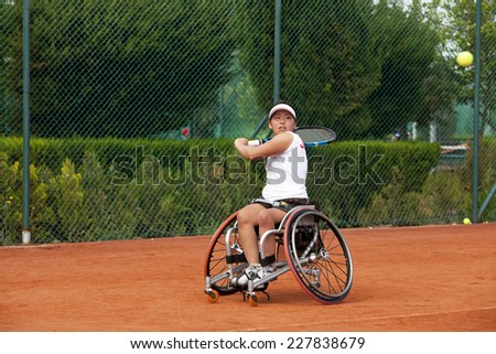Disabled Japanese female tennis player. - stock photo
