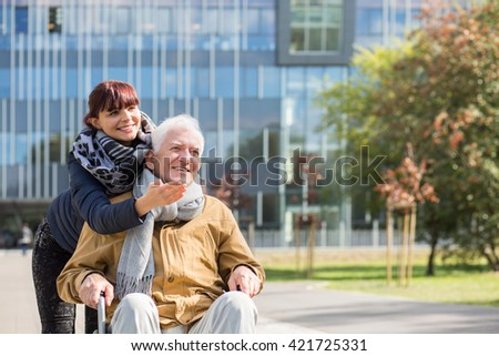 Disabled man on a walk with granddaughter - stock photo