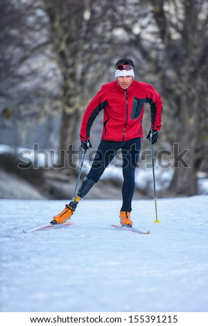 disabled man practicing nordic skiing - stock photo