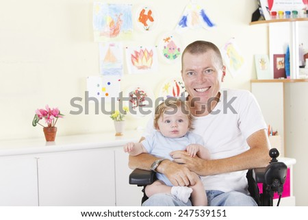 Disabled man with his son - stock photo