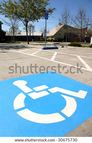 Disabled parking space indicators - stock photo