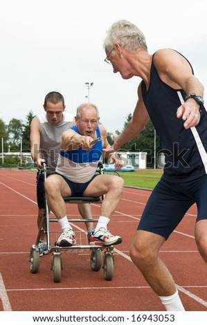 Disabled person and his helper reaching for an other athlete to pass him the baton. Caricature picture to illustrate helping, giving, disabilty, ability, getting older, not wanna quit. - stock photo