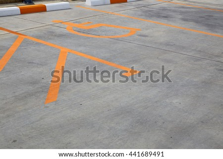 Disabled person parking place permit mark, traffic symbol on the road. - stock photo