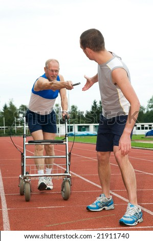Disabled person reaching for an other athlete to pass him the baton. Caricature picture to illustrate helping, giving, disability, ability, getting older, not wanna quit. - stock photo