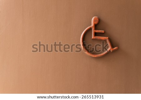 disabled person  sign on wooden wall - stock photo