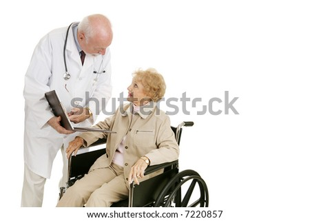 Disabled senior woman consults with her doctor.  Isolated with room for text. - stock photo
