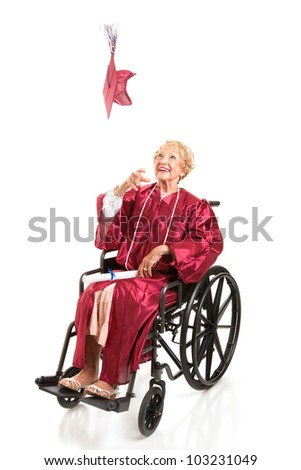 Disabled senior woman graduating college, tosses her cap in the air.  Full body isolated on white. - stock photo