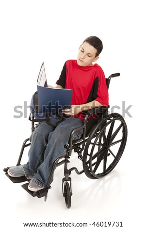 Disabled teen boy doing homework in his wheelchair.  Full body isolated on white.