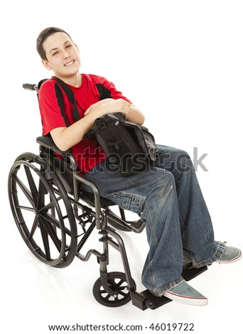 Disabled teen boy in his wheelchair with his backpack.  Full body isolated on white.