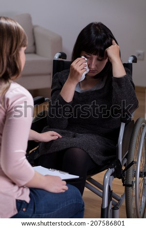 Disabled woman and her therapist at home