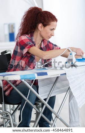 disabled woman during ironing at home
