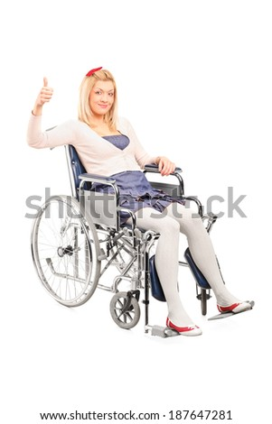 Disabled woman in a wheelchair giving thumb up isolated on white background - stock photo