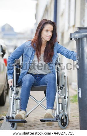 disabled woman rides a wheelchair - stock photo