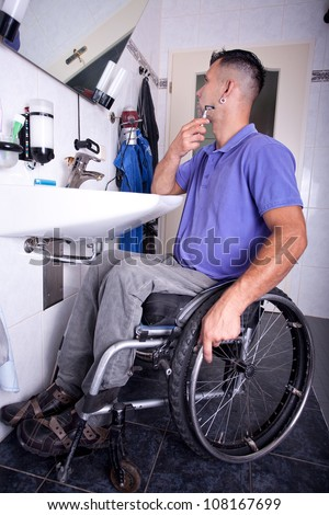 disabled young man in the wheelchair when shaving