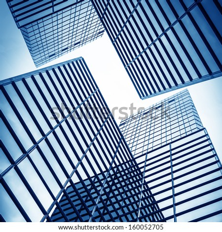 disappearing glass office buildings in the morning, wide angle view - stock photo