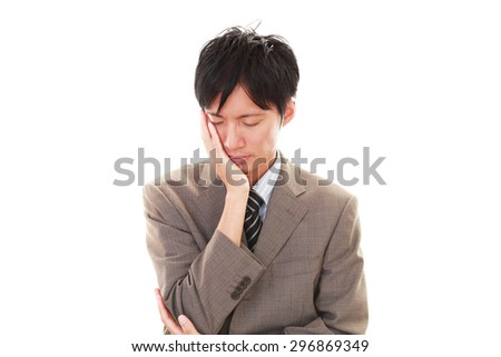 Disappointed Asian businessman