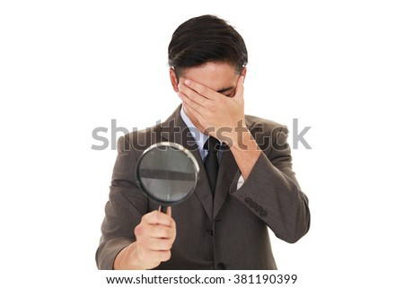 Disappointed Asian businessman - stock photo
