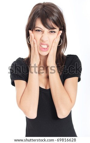 Disappointed attractive young woman with her hands around her face - stock photo