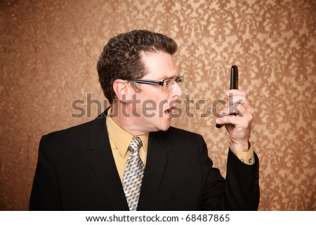 Disappointed Business Man Looking at His Phone - stock photo