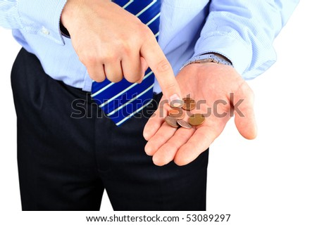 Disappointed businessman counting pennies - stock photo