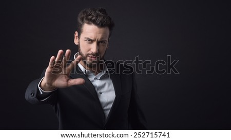 Disappointed businessman expressing denial with open hand raised - stock photo