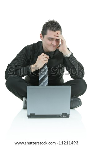 Disappointed businessman with a laptop computer - stock photo