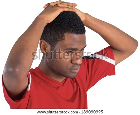 Disappointed football fan looking down on white background